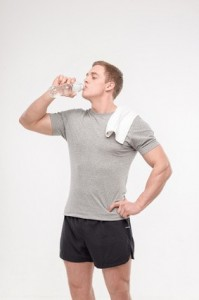 Athlete after workout with a water bottle